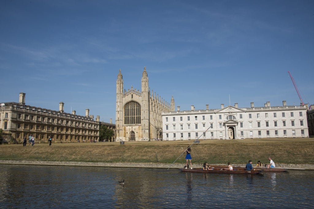 Summer school students punting down the River Cam in Cambridge